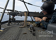 Sailor Prints - A Sailor Fires An M-240b Machine Gun Print by Stocktrek Images