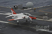 George Bush Prints - A T-45c Goshawk Lands Aboard Uss George Print by Stocktrek Images