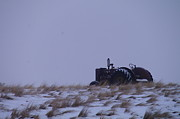 A Tractor Fading To The Snow  Print by Jeff  Swan