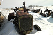Old Relics Posters - A Tractor In The Snow Poster by Jeff  Swan
