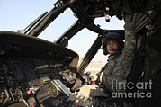 Helicopter Pilot Framed Prints - A Uh-60 Black Hawk Helicopter Framed Print by Stocktrek Images
