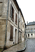 Weathered Houses Prints - A Very Old Street in France Print by Olivier Le Queinec