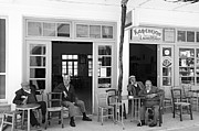 Lazing Prints - A village cafe in Crete Print by Laurence Delderfield