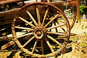 Old Relics Posters - A Wagon Wheel Poster by Jeff  Swan