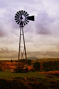 Rural Living Prints - A Windmill And Wagon  Print by Jeff  Swan