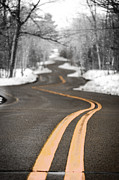 Flurries Posters - A Winter Drive Over A Winding Road Poster by Shutter Happens Photography