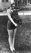 Swimsuit Photo Framed Prints - A Woman And Her Camera Framed Print by Underwood Archives