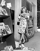 White Gloves Photo Posters - A Woman At A Magazine Stand Poster by Underwood Archives