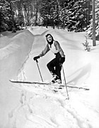 Cross Country Skiing Posters - A Woman Cross Country Skiing Poster by Underwood Archives
