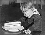 Hunger Posters - A Young Boy Ready For Cake Poster by Underwood Archives