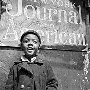 African-americans Posters - A Young Harlem Newsboy Poster by Underwood Archives