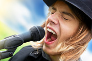 A Young Man Sings To A Microphone Print by Michal Bednarek