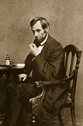 Famous Figures Posters - Abraham Lincoln Sitting at Desk Poster by Mathew Brady