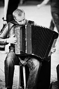 Buskers Photos - Accordion Player Playing Street Musician In Rynek Glowny Town Square Krakow by Joe Fox