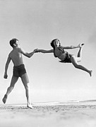 Beach Scenes Photo Prints - Acrobatic Beach Exhibition Print by Underwood Archives