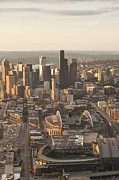 Baseball Stadiums Prints - Aerial view of the Seattle skyline with stadiums Print by Jim Corwin