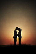 Woman In Summer Meadow Posters - Affectionate Couple At Sunset In Silhouette Poster by Lee Avison