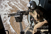 Featured Art - Afghan Air Force Gunner Fires An M-240 by Stocktrek Images