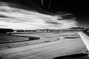 Air Travel Framed Prints - aircraft on runway and taxiway waiting to take off at McCarran International airport Las Vegas Framed Print by Joe Fox