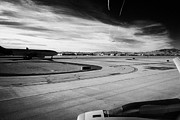 Air Travel Framed Prints - aircraft on runway and taxiway waiting to take off at McCarran International airport Las Vegas Nevad Framed Print by Joe Fox
