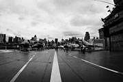 Naval Aircraft Prints - Aircraft on the flight deck of the USS Intrepid and flight island looking towards manhattan Print by Joe Fox