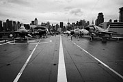 Manhaten Framed Prints - Aircraft on the flight deck of the USS Intrepid looking towards manhattan new york Framed Print by Joe Fox
