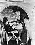 Airline Industry Photo Posters - Airline Steward Serves Woman Poster by Underwood Archives