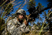 Featured Art - Airman Aims An M-4 Assault Rifle by Stocktrek Images
