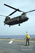 Chinook Framed Prints - Airman Directs An Army Ch-47 Chinook Framed Print by Stocktrek Images