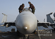 Enterprise Framed Prints - Airmen Clean The Canopy Of An Fa-18f Framed Print by Stocktrek Images
