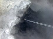 Thunderhead Photos - Airplane flying above dark clouds by Matthias Hauser