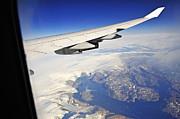 Sami Sarkis - Airplane wing over snowy and rocky coastline