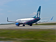 Passenger Plane Metal Prints - AirTran Ready for Take Off Metal Print by Thomas Woolworth