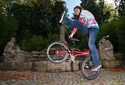 Bmx Posters - Alive and kicking - BMX Flatland power girl Poster by Matthias Hauser