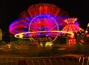 Carnivals Photos - All The Rides Moving At Once by Jeff  Swan