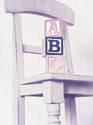 Wooden Blocks Framed Prints - Alphabet Blocks Chair Framed Print by Edward Fielding