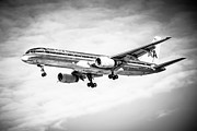 Flying Photos - Amercian Airlines 757 Airplane in Black and White by Paul Velgos