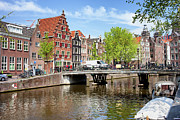Old Home Place Posters - Amsterdam Canal Bridge and Houses Poster by Artur Bogacki