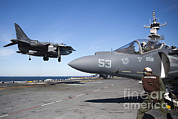 Featured Art - An Av-8b Harrier Lands On The Flight by Stocktrek Images