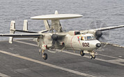 On The Runway Photos - An E-2c Hawkeye Landing On The Flight by Giovanni Colla