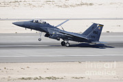 Featured Acrylic Prints - An F-15c Eagle Landing On The Runway Acrylic Print by Remo Guidi
