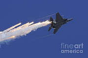 Featured Metal Prints - An F-15e Strike Eagle Releases Flares Metal Print by Remo Guidi