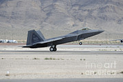 Featured Metal Prints - An F-22 Raptor Landing On The Runway Metal Print by Remo Guidi