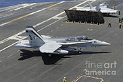 F-18 Photo Prints - An Fa-18 Hornet Of The U.s. Navy Aboard Print by Remo Guidi