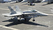 F-18 Photo Prints - An Fa-18 Hornet Of The U.s. Navy Print by Remo Guidi
