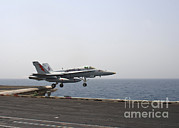 Enterprise Posters - An Fa-18c Hornet Takes Poster by Stocktrek Images