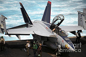 Enterprise Framed Prints - An Fa-18f Super Hornet Sits Framed Print by Stocktrek Images