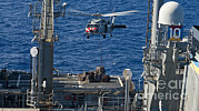 An Mh-60s Sea Hawk Delivers Supplies Print by Stocktrek Images