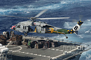 Bridge Deck Framed Prints - An Mh-60s Sea Hawk Helicopter Picks Framed Print by Stocktrek Images