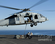 Pallet Framed Prints - An Mh-60s Sea Hawk Helicopter Prepares Framed Print by Stocktrek Images
